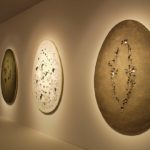 A wall of Concetto Spaziale artworks by Lucio Fontana @ Tornabuoni, Art Basel 2017